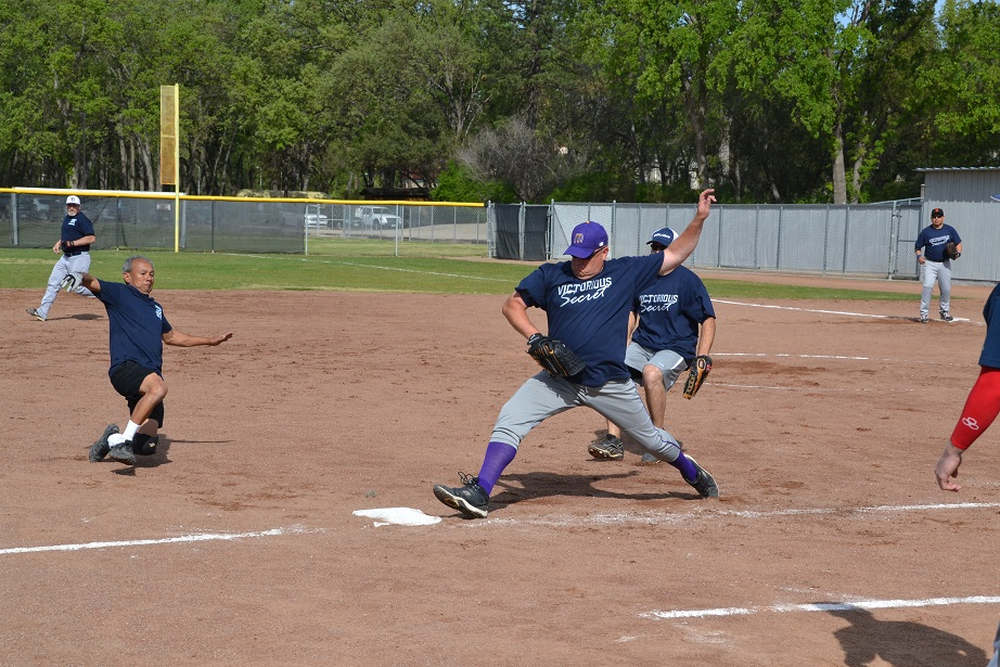 Paul Varner beats the slide for an out at third