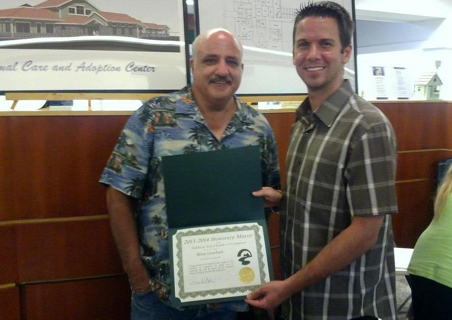 Honorary Mayor outgoing Burton hands over Mayoral duties to Brian Gearhart for 2013-14 Mayors Race in Oakhurst -- Photo by Tim Madden