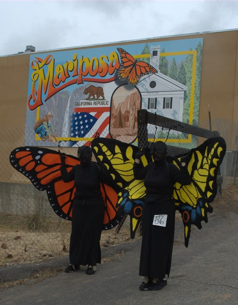 Mariposa Butterfly Festival - Human Butterflies before Mariposa Mural - Photo courtesy of Charles Phillips Stone Creek Gallery Mariposa