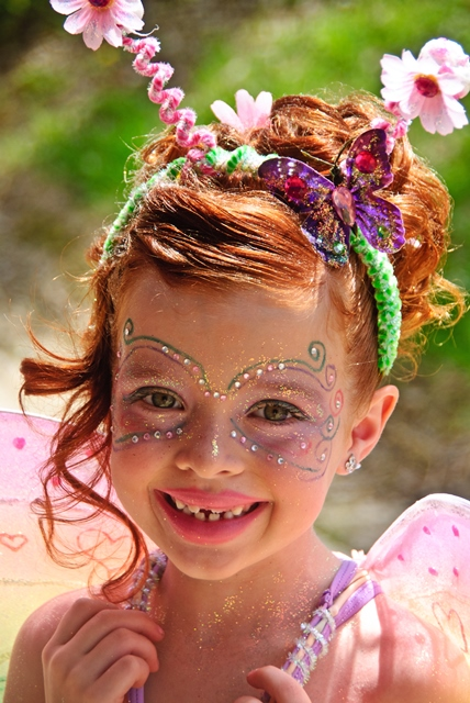 Mariposa Butterfly Festival - Little girl with butterfly makeup smiling - Photo courtesy of Charles Phillips Stone Creek Gallery Mariposa