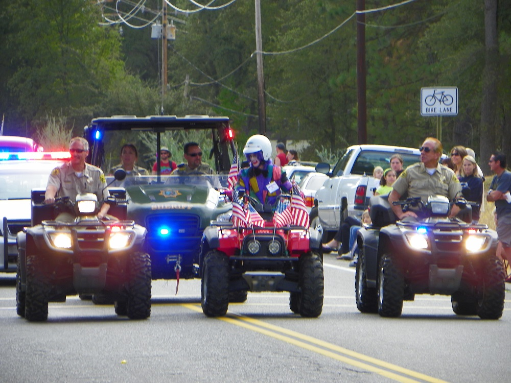 Mountain Heritage Days Parade 2013 - Sometimes clowns need a proper escort - Photo by Kellie Flanagan