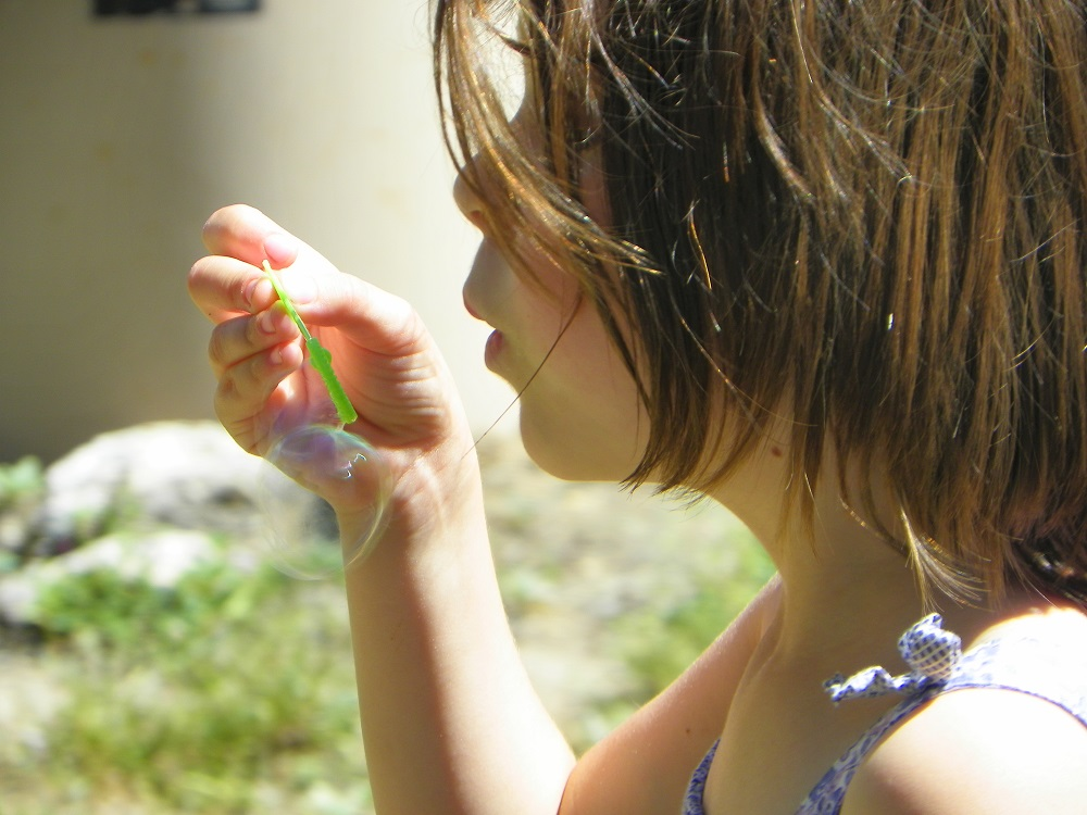 Music in the Meadow - 2013 - girl blowing bubbles - Photo by Kellie Flanagan