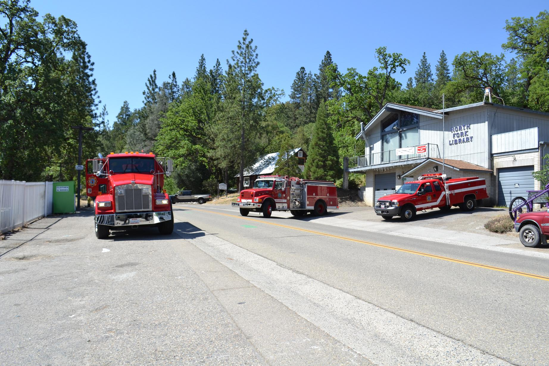 Engine Squad and Water Tender 11 leave old station for the last time