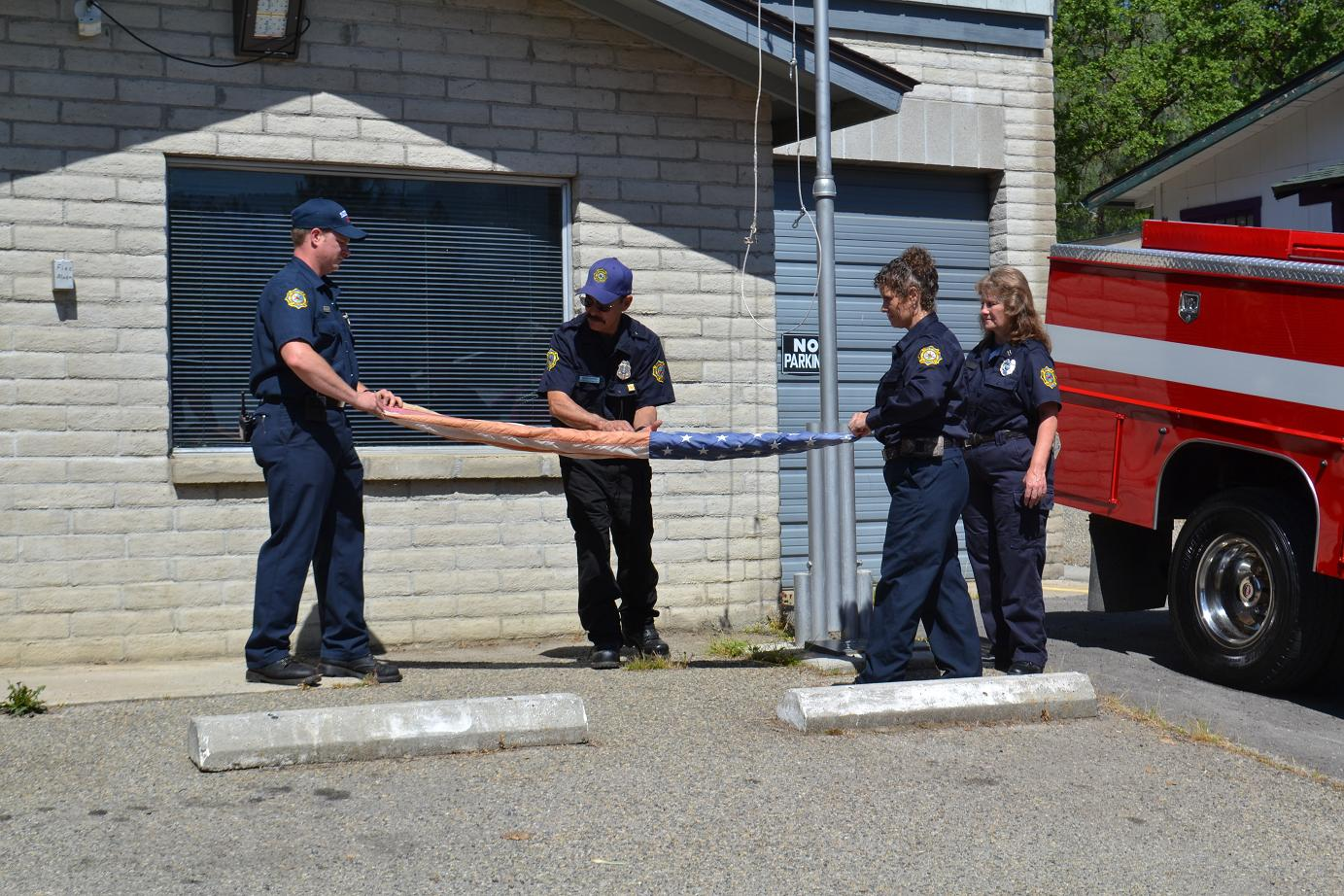Folding the old flag at Station 11