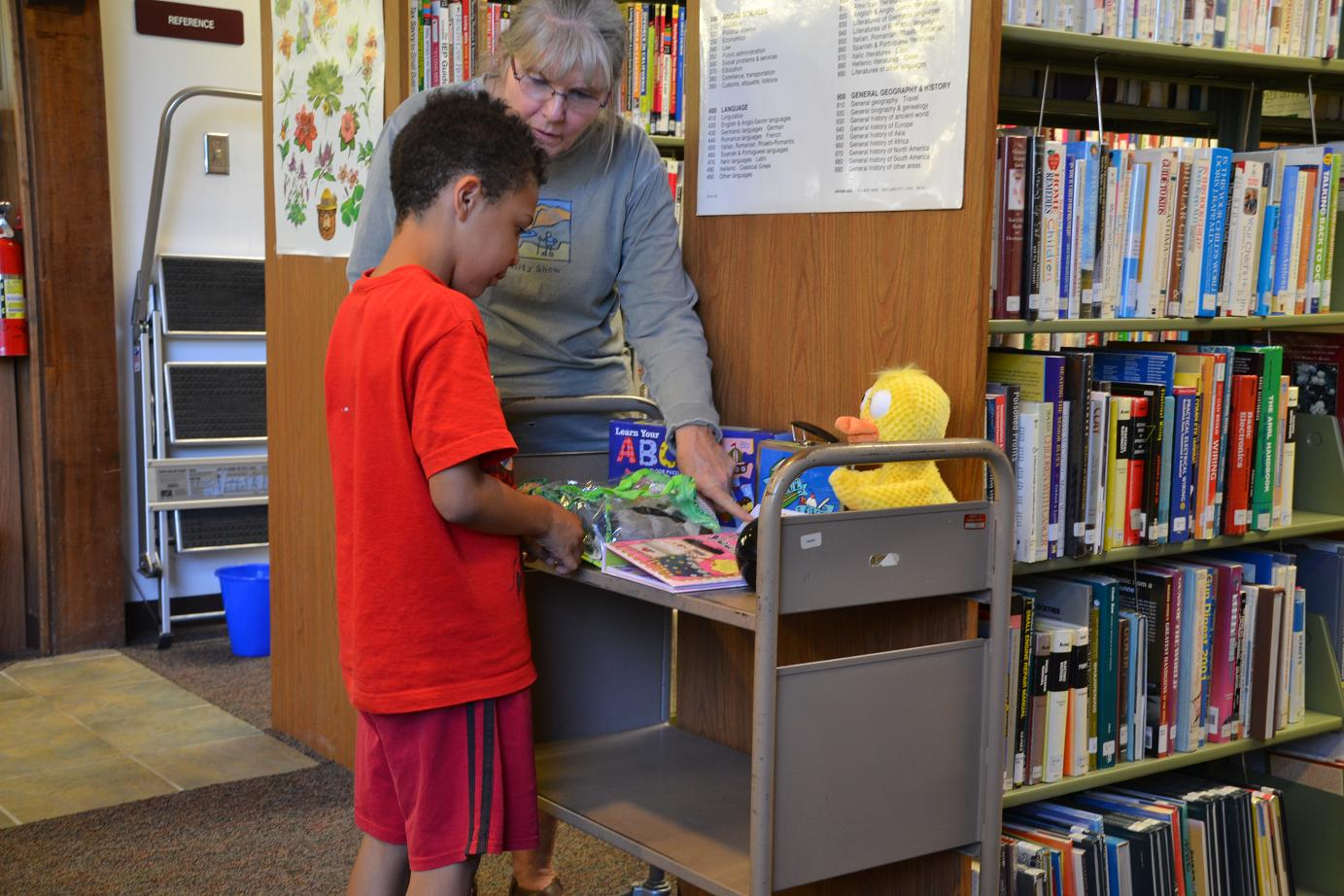 Kids choose a book or toy for turning in reading log each week