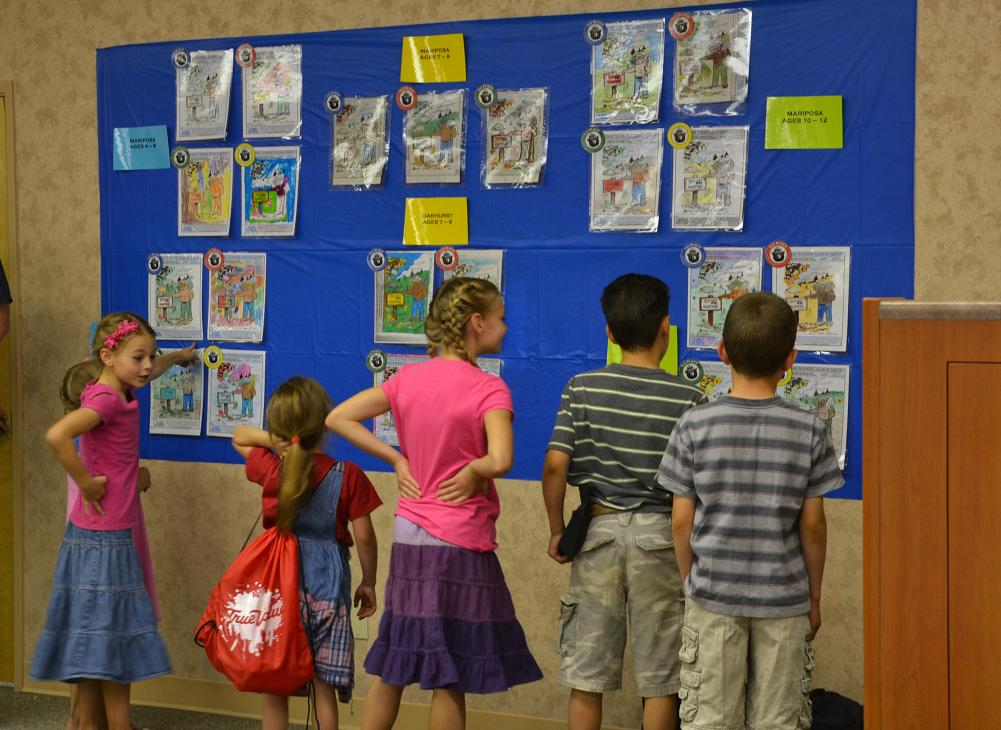 Kids check out their artwork on the big board