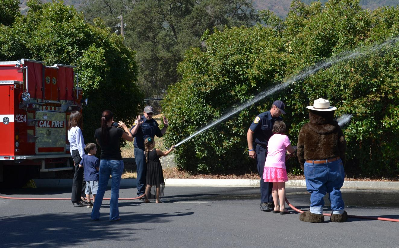 Kids try their hand at working the water hose
