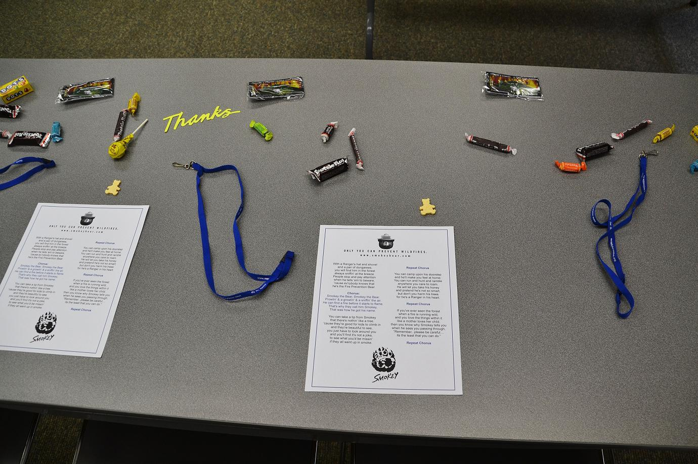 Table with goodies and words to the Smokey Bear Song