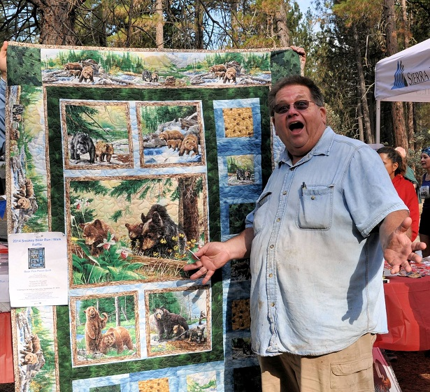 Steve Miller wins the quilt raffle - photo courtesy of SierraTel