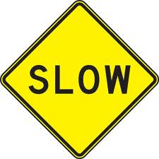 Slow sign in Public Domain - Wiki commons - 2013
