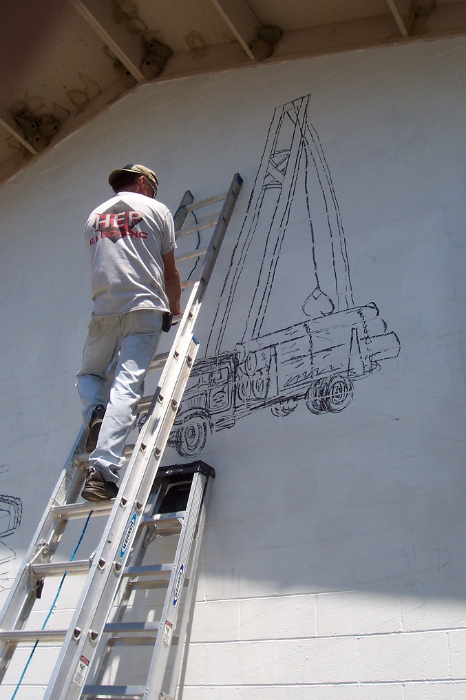 Clayton working on the North Fork Supermarket mural