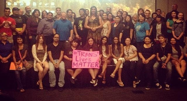 "Karen Adell Scot at Fresno State event with poster and participants  ""Trans Lives Matter"" 2014"