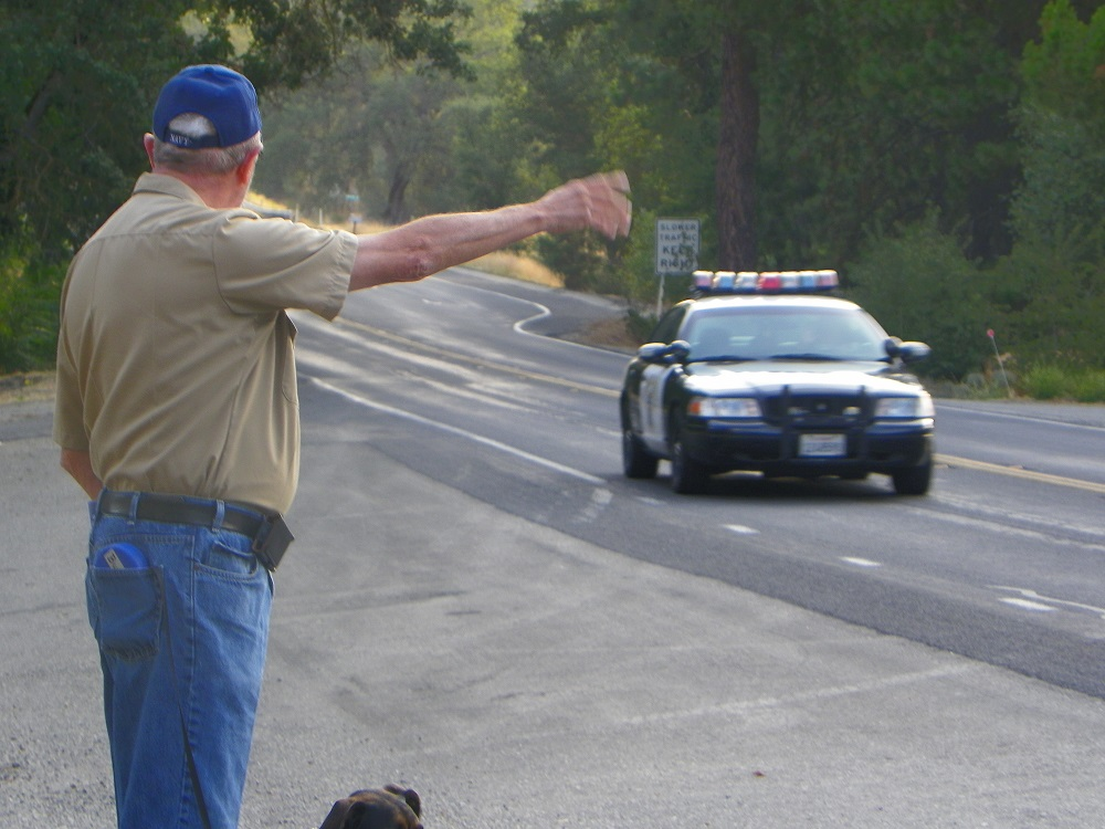 Waving Man Bill Briggs with CHP car - 2013 - photo by Kellie Flanagan