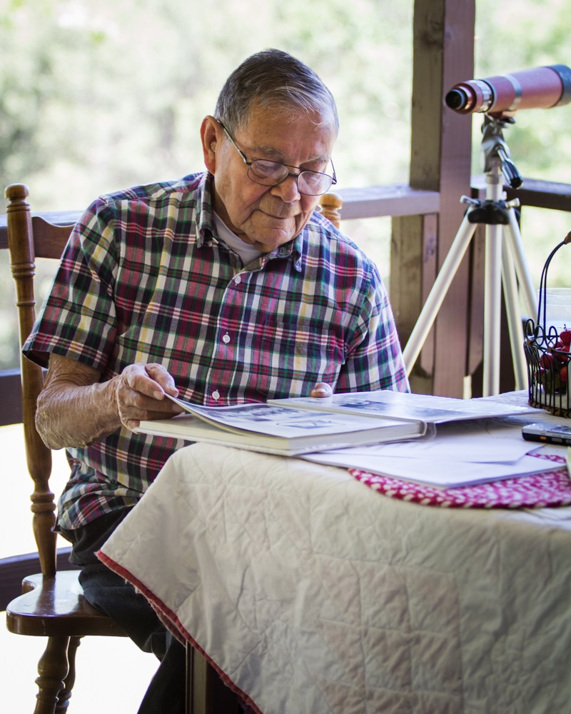 Sarge reading the book his daughter Alicia Becker created in honor of his 90th birthday - photo by Virginia Lazar