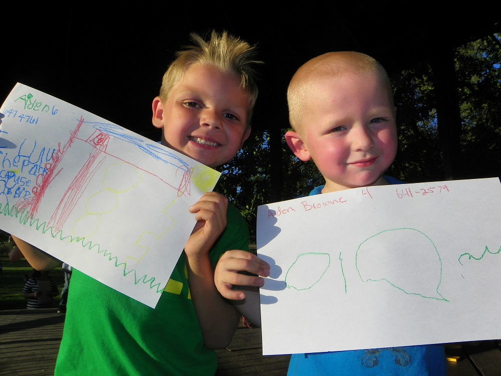 Community Park Sept 2013 - Aiden McCarty and Aiden Browneproudly show their drawings of the park - Photo by Kellie Flanagan